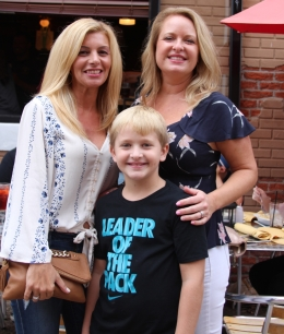 Sisters-in-law, Jeanine Adams and Kristie McGinnis with a smiling Logan McGinnis